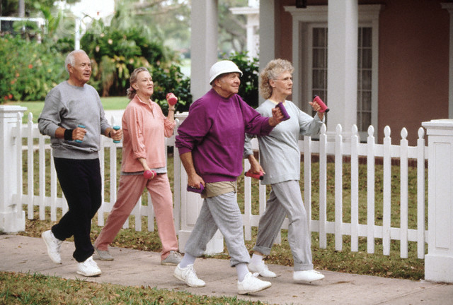 Seniors power-walking --- Image by © Tom & Dee Ann McCarthy/CORBIS
